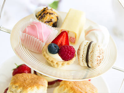 Afternoon tea on a white cake stand