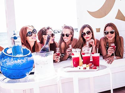 Five girls drinking cocktails outside