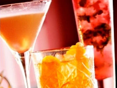 A selection of cocktails against a red background