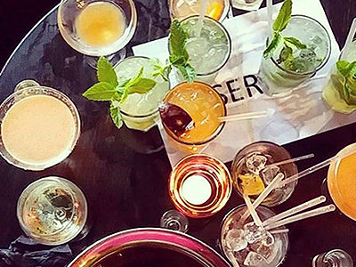 A variety of cocktails spread out on a tabletop