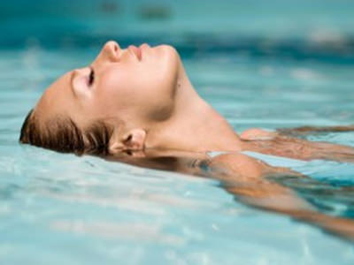 Woman lying on her back in a swimming pool