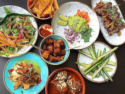 A top-down view of multiple plates of Latin American food