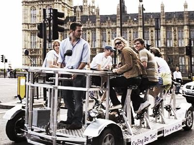 Group ride on Pedi bus outside the House's of Parliament