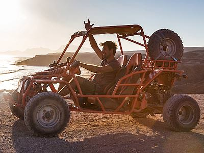A man in an off-road buggy