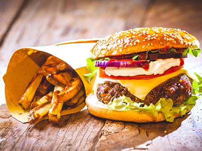 A cheeseburger and fries on a wooden table