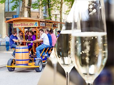 Split image of a beer bike and two glasses of Prosecco