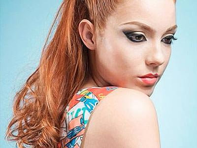 A ginger girl with a full face of make up on