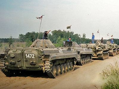 A line of tanks on a dirt road