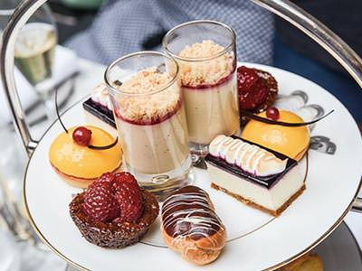 Afternoon tea desserts on the top tier of a cake stand