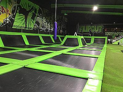 A trampoline zone Flip Out written in the background