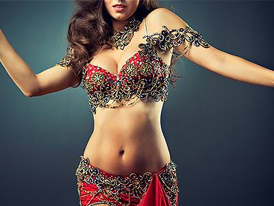 A woman dancing with a Bollywood style bikini on