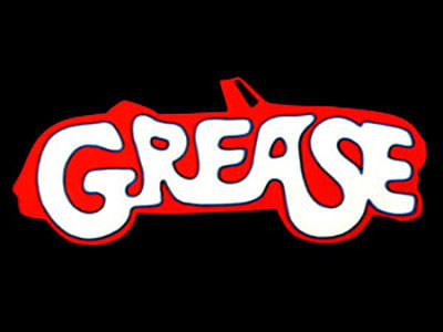 The Grease 'car' logo against a black background