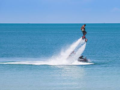 A man flyboarding over the ocean