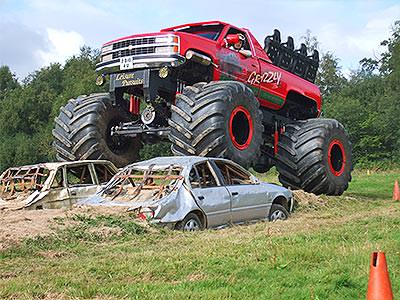A Monster Truck crushing a car