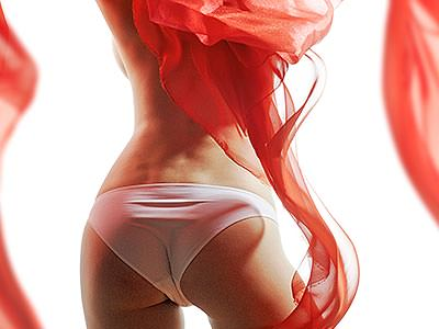 The back of a woman's body in white knickers, surrounded by floaty red net