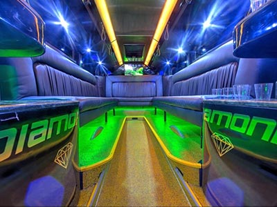 Women dancing in the inside of a party bus