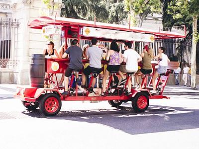 A large group of people sitting on a beer bike