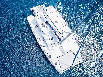 An areal shot of a yacht on the water