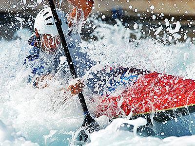 Someone kayaking through a river