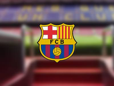 Barcelona FC logo over a blurred image of the pitch at Nou Camp