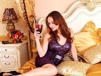A woman in a purple dress in bed