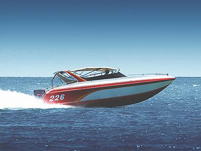 A red and white speedboat, sailing on the sea