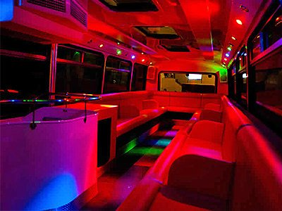 The interior of a party bus with red lighting