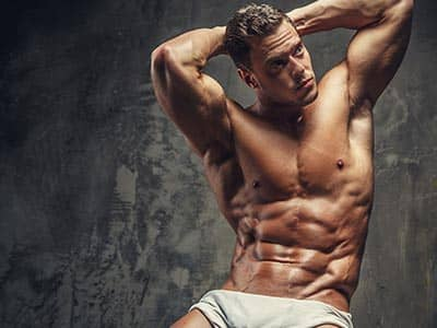 A semi-naked man in whit underwear