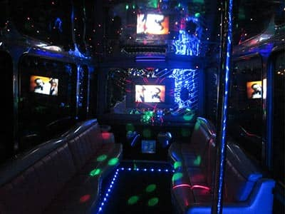 Interior of a party bus lit-up with lights