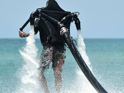 The back of a man in a flyboard