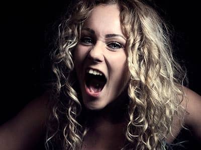 Close up of a blonde woman shouting