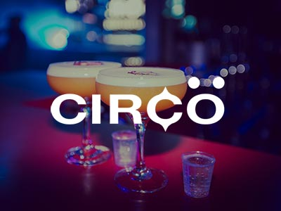 Two porn star martinis with the Circo logo overlapping