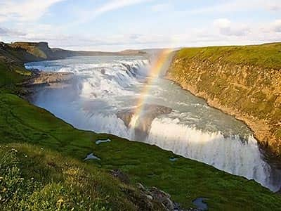 Gullfoss waterfall in Iceland, Reykjavik with a rainbow over it