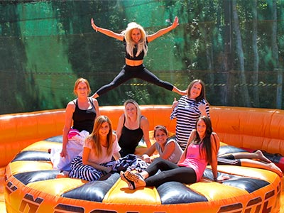 A group of women on an inflatable obstacle