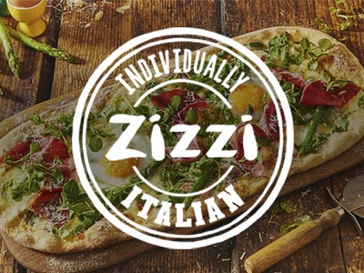 White Zizzi logo placed over an image of a pizza