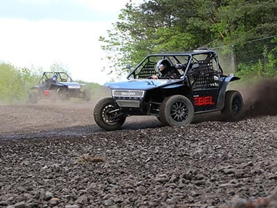 A rally buggy racing over a drink track