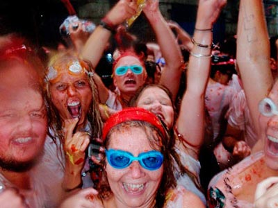 People playing at La Tomatina Festival in Valencia