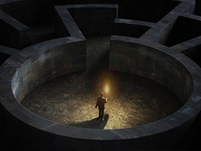 A man holding a torch in a maze