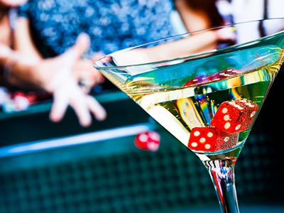 A martini glass with two dice in