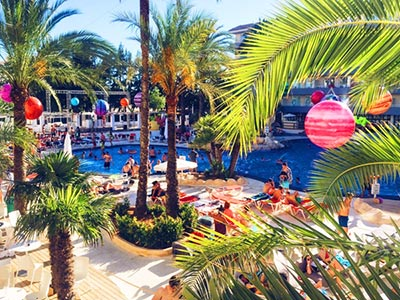 A pool shot with people lounging and swimming at BH Mallorca
