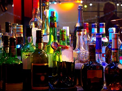 Lots of bottles on a bar