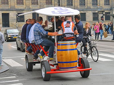 Some men driving a beer bike