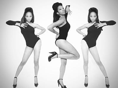 three women dancing in black leotards