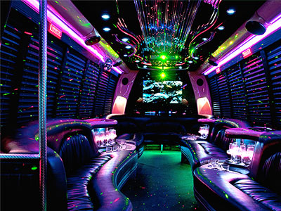 The interior of a lit-up party bus