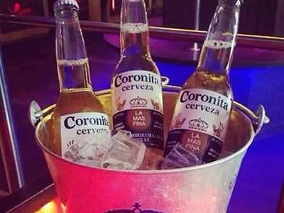 Close up of three bottles of Corona in an ice bucket