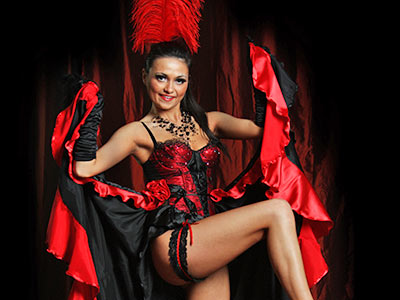 A woman in a red ad black burlesque outfit