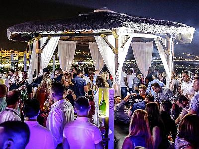 A large canopy on the rooftop terrace of Pangea, with people dancing underneath and around at night