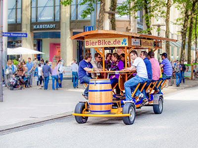 A beer bike with lots of men on