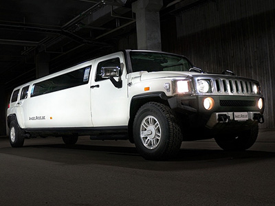 A white Hummer limo parked up