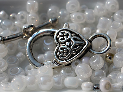 A silver charm in some beads